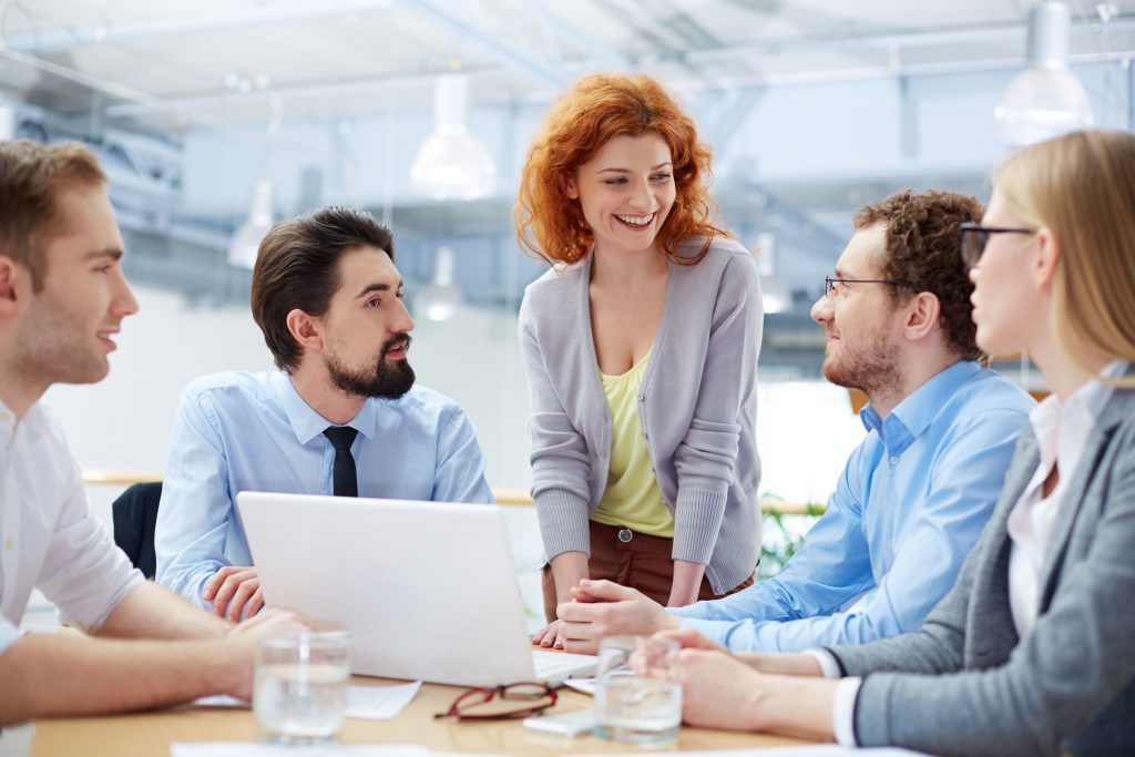 28753147 - group of business partners sharing ideas upon computer project at meeting