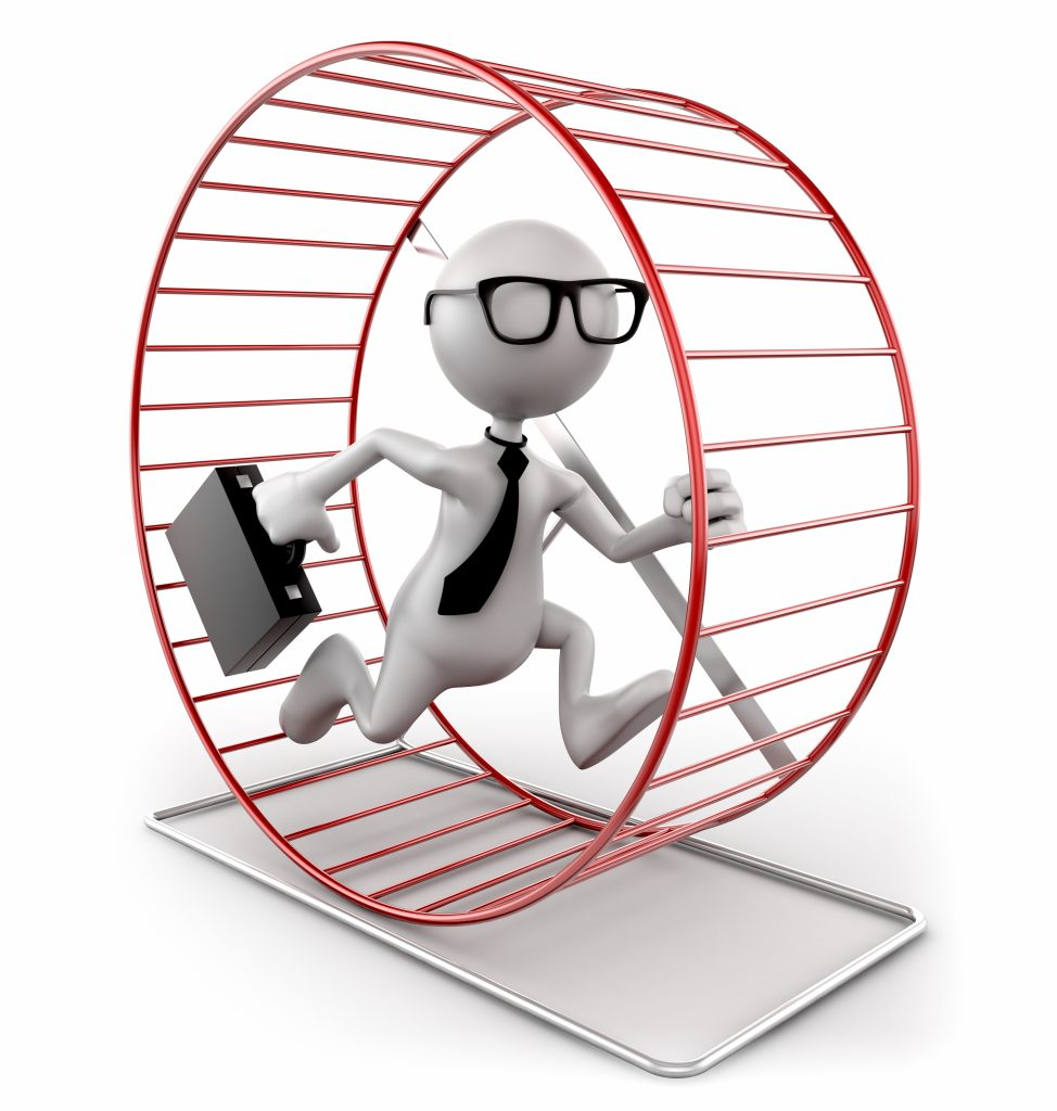 """Businessman running in exercise wheel, isolated w. clipping path"""